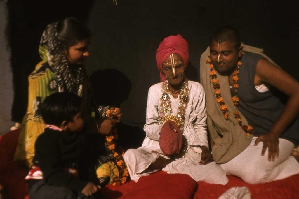 Radha Govinda Babaji Maharaja and Sadhu Maharaja's wife, his son Priyesh and himself